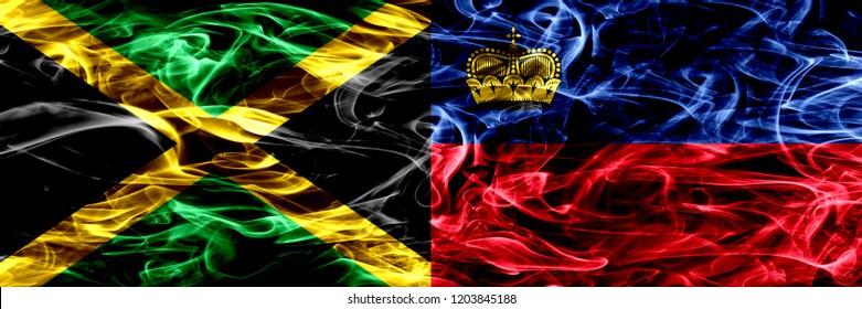 Jamaica vs Liechtenstein, Liechtensteins smoke flags placed side by side. Thick colored silky smoke flags of Jamaican and Liechtenstein, Liechtensteins
