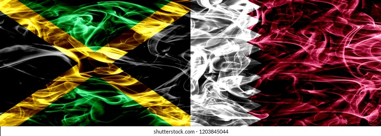 Jamaica vs Qatar, Qatari smoke flags placed side by side. Thick colored silky smoke flags of Jamaican and Qatar, Qatari