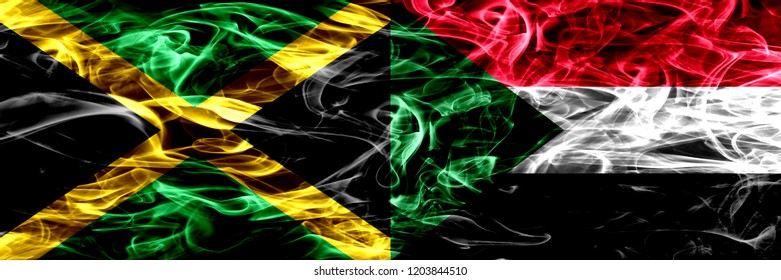 Jamaica vs Sudan, Sudanese smoke flags placed side by side. Thick colored silky smoke flags of Jamaican and Sudan, Sudanese