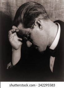 James Joyce (1882-1941), Irish writer and author of ULYSSES (1922) and FINNEGANS WAKE (1939) in 1922 portrait.