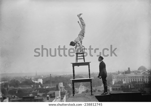 Jammie Reynolds, balancing on the on chairs on the edge of a rooftop in Washington, DC ca. 1921