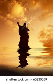 Jesus Christ on Water pointing the way heavenwards silhouette with light bouncing off Cross held upright