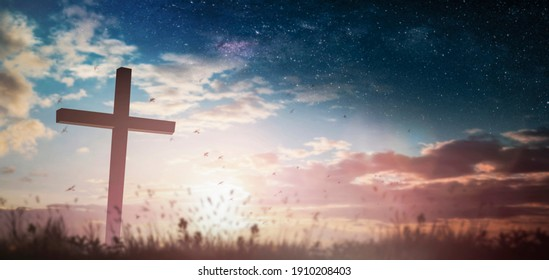 Jesus cross crucifixion on calvary hill in sunrise good Friday risen in easter day morning Sunday concept for Christianpraise forholy spirit religiousGod,Catholic church praystar dawn background.
