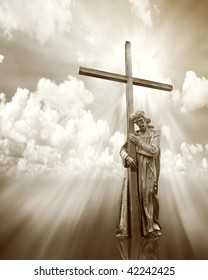 jesus holding a cross on cloud sepia background