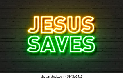 Jesus saves neon sign on brick wall background