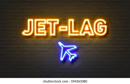 Jet-lag neon sign on brick wall background