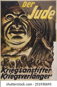 The Jew: Warmonger, War Elongater'. 1940s German Anti-Semitic Poster. It accuses Jews of starting World War 2 and of perpetuating it. By Hans Schweitzer, created under his pseudonym, 'Mjolnir'