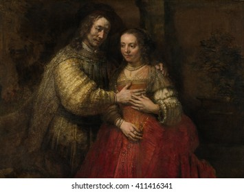 The Jewish Bride, by Rembrandt van Rijn, c. 1665-69, Dutch painting, oil on canvas. Richly costumed couple, with man placing his hand on the breast of the woman, and his left arm over her shoulders.