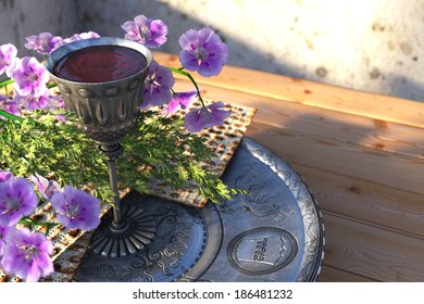 Jewish celebrate pesah passover with matzo and flowers holiday background