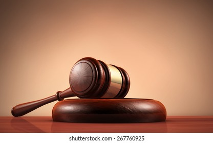 Judge, law, lawyer and Justice concept with a close-up 3d rendering of a gavel on a wooden desktop with dark red-brown background.