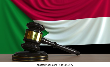 Judge's gavel and block against the flag of Sudan. Sudanese court conceptual 3D rendering
