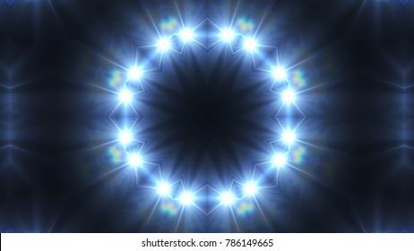 kaleidoscope blue light pattern spotlights on the dark background