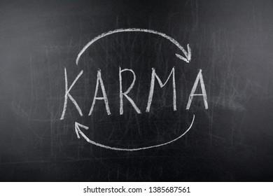 Karma written on black chalkboard