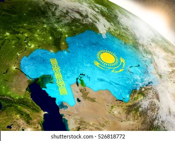 Kazakhstan with embedded flag on planet surface during sunrise. 3D illustration with highly detailed realistic planet surface and visible city lights. Elements of this image furnished by NASA.