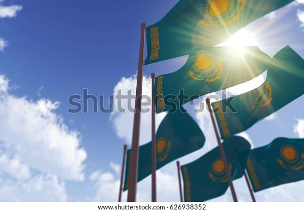 Kazakhstan flags waving in the wind against a blue sky. 3D Rendering
