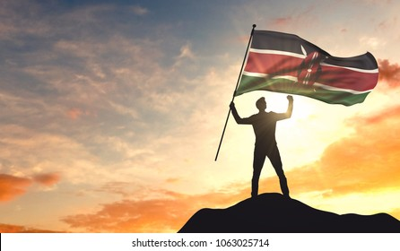 Kenya flag being waved by a man celebrating success at the top of a mountain. 3D Rendering
