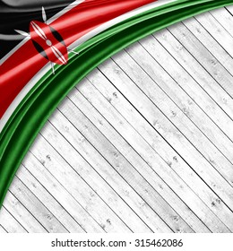 Kenya flag   of silk with copyspace for your text or images and wood background