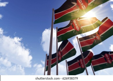 Kenya flags waving in the wind against a blue sky. 3D Rendering