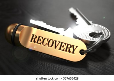 Keys with Word Recovery  on Golden Label over Black Wooden Background. Closeup View, Selective Focus, 3D Render.