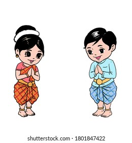 Khmer (Cambodian) kids, a boy and a girl wearing Khmer transitional costume greeting people with their hand gesture (Chum Reap Sour). Happy Khmer New Year!