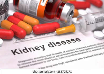 Kidney Disease - Printed Diagnosis with Red Pills, Injections and Syringe. Medical Concept with Selective Focus.