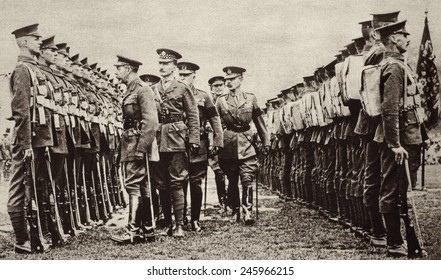 King George V inspects new recruits of the British Army who will soon be sent to the Western Front in France. At right is the Secretary of War, Field Marshal Horatio Kitchener. Ca. 1914-1916.