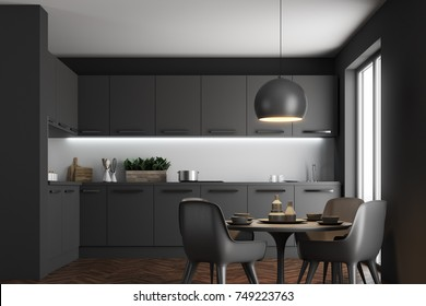 Kitchen interior with black walls, a wooden floor, black countertops, a table and chairs. 3d rendering mock up