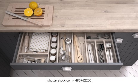 Kitchen opened drawer full of kitchenware, 3D illustration
