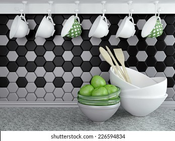 Kitchen utensils on the marble worktop. Ceramic and glass kitchenware in front of modern wall tile.
