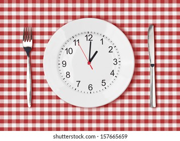 Knife, white plate with clock face and fork on red picnic table cloth