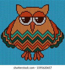 Knitting of cartoon funny and sad owl with big eyes in turquoise and orange hues on the pale blue background, illustration for textile production