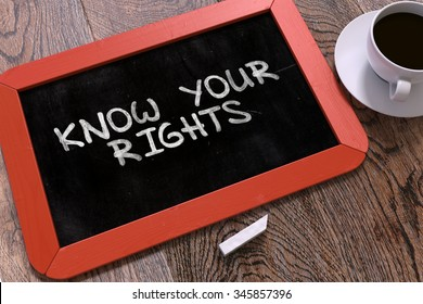 Know Your Rights Handwritten by white Chalk on a Blackboard. Composition with Small Red Chalkboard and Cup of Coffee. Top View.