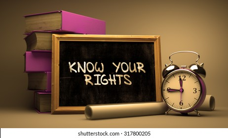 Know Your Rights Handwritten on Chalkboard. Time Concept. Composition with Chalkboard and Stack of Books, Alarm Clock and Scrolls on Blurred Background. Toned Image.