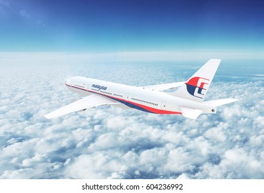 KUALA LUMPUR, MALAYSIA - CIRCA 2017: In-flight view of Malaysia Airlines Boeing 777 Commercial Passenger Aircraft Flying High Up in the Sky Above the Clouds. 3D Illustration.