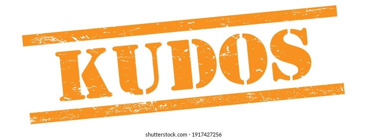 KUDOS text on orange grungy vintage rubber stamp.