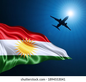 Kurdistan flag of silk at night with an airplane on the sky background-3D illustration