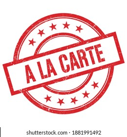 A LA CARTE text written on red round vintage rubber stamp.
