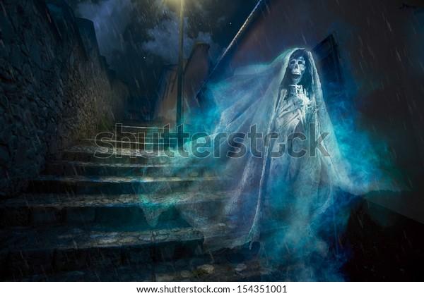 "La llorona, mexican scary ghost floating on a street at night, seasonal Halloween ""dia de los muertos"" photo composite"