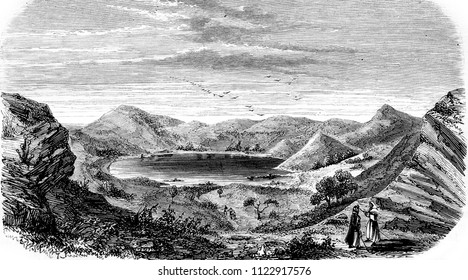 Lake on mountains, vintage engraved illustration. Magasin Pittoresque 1855.