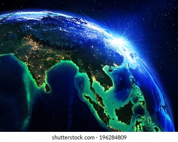 land area in India, China and Indonesia the night - maps elements of this image furnished by NASA