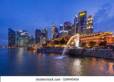Landmark of Singapore Merlion Statue city in the Downtown Background at night