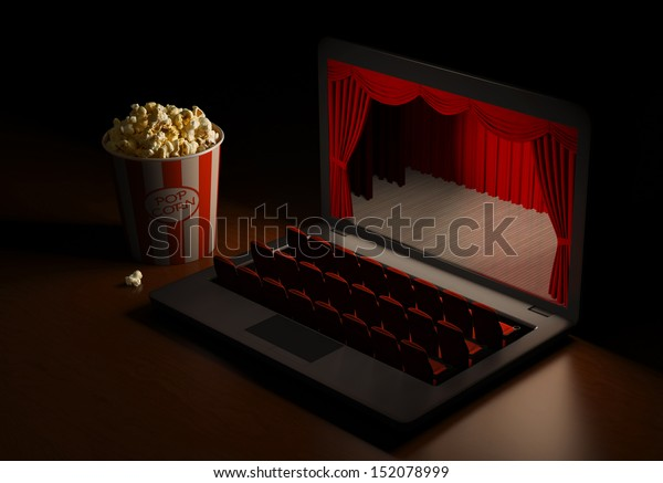 Laptop as an cinema. Home entertainment. View the video by subscription. Home Theater.
