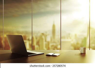 laptop, cup and diary on table in office - Shutterstock ID 257280574