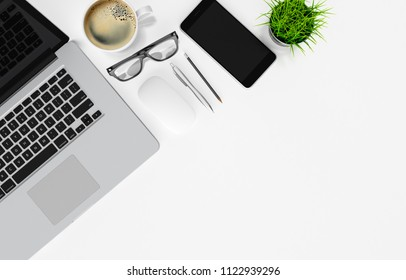 Laptop and other devices on white office desk, top view with copy space, 3d rendering