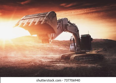 Large backhoe or digger with raised bucket at sunset backlit by a fiery sun as it stands in an industrial earth excavation site with sun flare. 3d rendering
