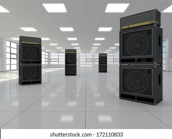 A large empty room in which there are guitar amps