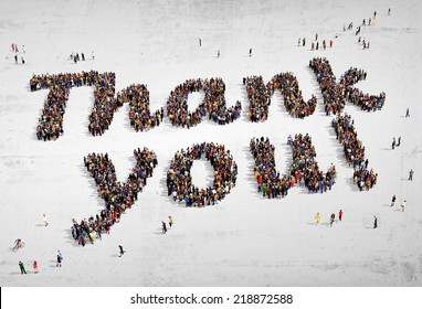 """Large group of people seen from above, gathered in the shape of """"Thank you!"""" text, on concrete background"""