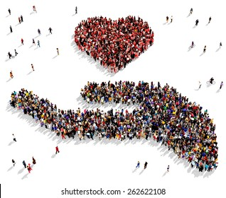 Large group of people seen from above gathered together in the shape of a hand holding a heart symbol