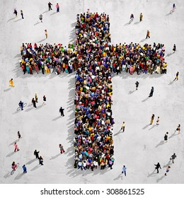 Large group of people seen from above gathered together around the shape of a cross, on concrete background