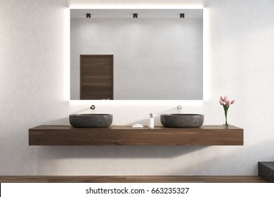 Large horizontal mirror is hanging on a white bathroom wall. There are two sinks on a wooden shelf below it and a vase of flowers. 3d rendering